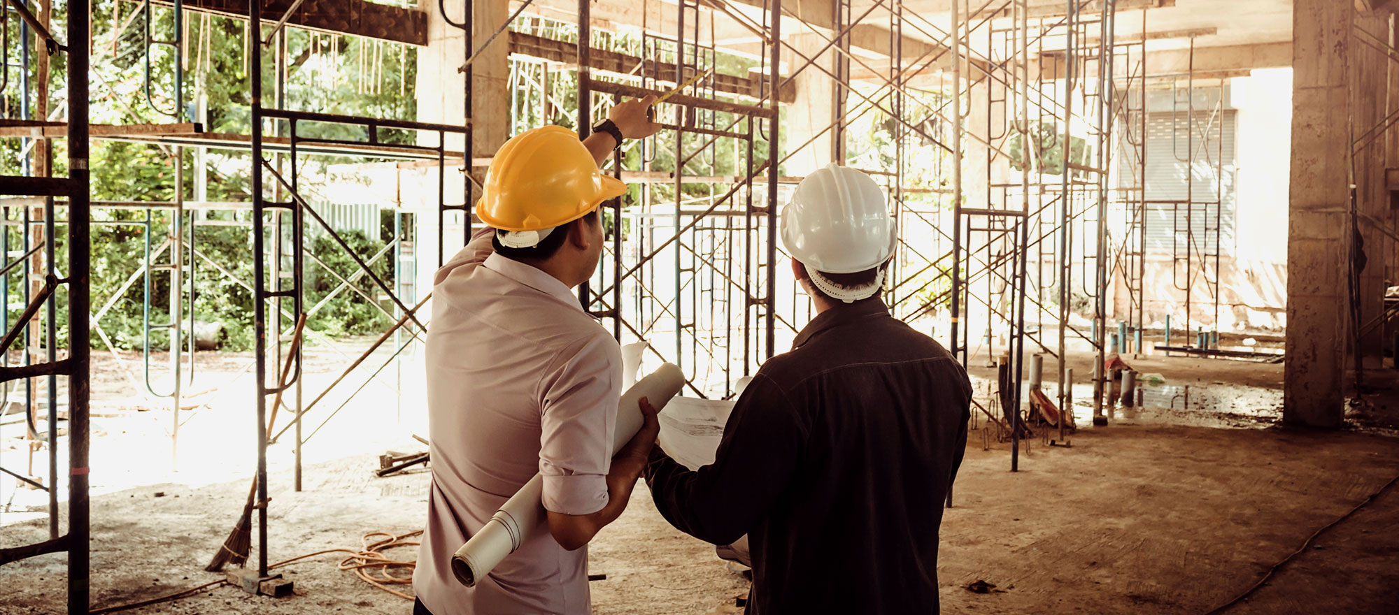 Business man and engineer on construction site