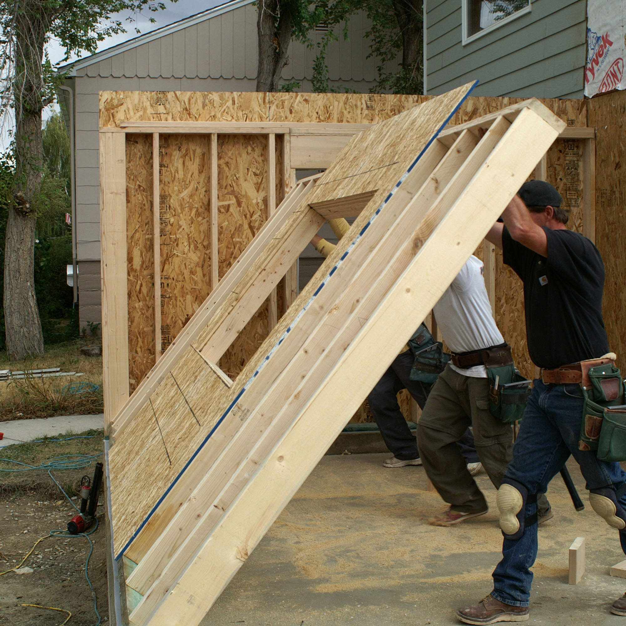Framed exterior wall going up on addition for existing home