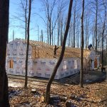 different view of home with partial tyvek on