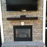 shelving unit on fireplace