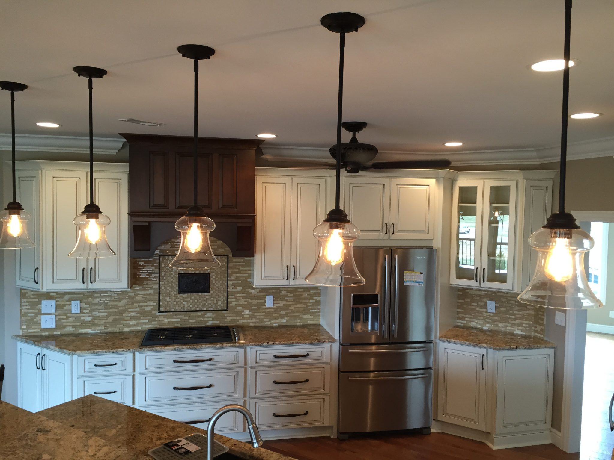 close up of hanging lights in kitchen